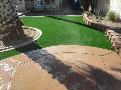 Stamped concrete with artificial grass installation
