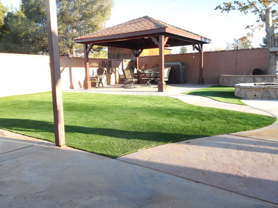Stamped concrete, artificial grass and freestanding gazebo