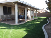 Lancaster aluminum patio cover and synthetic lawn