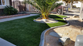 Drought tolerant front yard with artificial turf in Lancaster